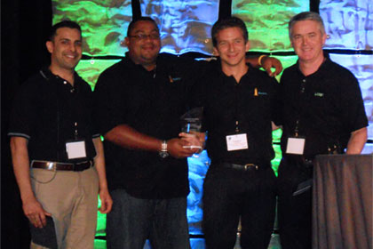 Renato Lezama, Beacon, VP Regional Operations (2nd left) and Christopher Woodhams, Beacon, CIO (2nd right), accepting the Customer of the year Award at the 2012 International LANSA User Conference.
