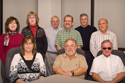 The BNE development team, clockwise: Phyllis Hardee, Deborah Webb, George Staton, Roland Letchworth, Frank Folsom, Jimmie Hudson, Wayne Wobbleton, Randy Griffin, Paula Wright.
