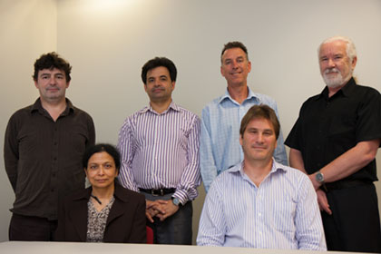 IT Manager Ms Mitra Bhar (sitting on the left) with the OBOS Applications Development team, standing from left to right Jim Watterson, Vince Lazzaro, Brett Ecclestone, Michael Major and sitting  Muir Mathieson.