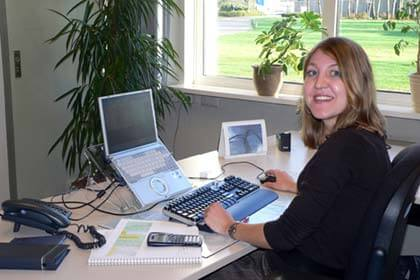 Sales representative Madeline Kroesbergen uses the Visual LANSA solution on her laptop